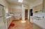 High Ceilings & wood floors make this kitchen delightful