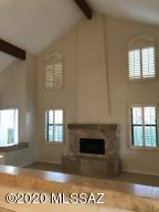 beautiful high ceilings, windows and fireplace