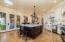 Large center Island with seating for 5, marble countertops and backsplash