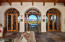 3 sets of French Doors lead to large covered Patio with negative edge pool and spa with water fall.