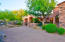 Circular driveway includes parking area for guests by gated courtyard entry.