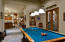 The rec room can be used for billiards or as a media room! The double french doors lead to a covered BBQ patio.