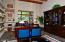 The large home office includes built-in shelving and is located in the North wing near the master.
