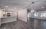 This shows the relationship from the dining area into the kitchen and living