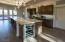 Large island kitchen with wine cooler and room for tucked-in bar stools