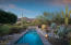 Enjoy lovely views, beautiful desert landscape and a lap pool in the backyard.