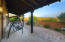 Additional Angle of Wrap Around Covered Patio Area Off of Master Bedroom showcasing City, Desert, and Mountain Views.