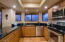 Kitchen, featuring grantie counter tops and all stainless steel appliances recently replaced.