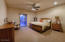 Spacious Master Bedroom With Sliding Glass doors Leading To Back Back Wrap Around Patio