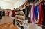 Master Bedroom walk In Closet With Built In Storage and Ample Storage. Includes Entry/Exit from Bedroom and Bathroom With Mirriors On Both Doors.