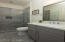 Modern style vanity, tile surround shower with glass shower door