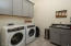 Laundry room with extra storage and sink