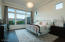 Enjoy sunrise views over the Catalina mountains from this spacious master suite.