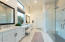 Absolute perfection would describe this master bath with large glass enclosed shower, dual vanities and walk-in closet