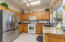 New granite countertops with alder cabinets.