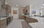 Lovely cabinetry, quartz countertops gorgeous natural light, kitchen opens to dining and family room