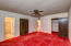 Master Bedroom With Standard Closet & Walk In Closet & Groovy Red Plush Carpet. Looks Out To The North