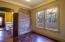 Spare bedroom features stylish steel doorway divider