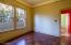 Spare bedroom features mesquite parquet flooring