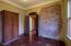 Spare bedroom features original plaster over brick