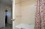 """Roomy hall bath -- tiled as is the rest of the home with 24"""" tile."""
