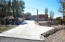 Street view of expansive concrete driveway with extra guest pull outs.