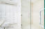 HAND CRAFTED BUILT IN CABINETRY AND DOUBLE DOOR SHOWER IN OWNER'S BATHROOM