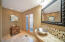 Beautifully appointed half bath for guests when entertaining.