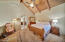 Vaulted ceilings adorn the master bedroom.