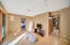 The common area of the lower level is just off three bedrooms, full bath and second laundry area.