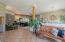 viga beams and tile floors in main living area