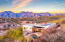Enjoy sensational mountain, sunrise and sunset views from this exceptional lot.