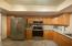 Spacious kitchen offers lots of storage and easy access to dining room and greatroom.