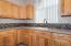 Stonemark counters in kitchen.