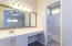 En- suite with step-in shower.