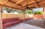 Covered rear patio with terraced garden area