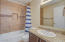 Updated hall bath with granite top and tub/shower