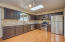 Updated kitchen includes SS appliances and granite tile countertops