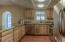 Updated & open kitchen with Hickory cabinets, granite counters & stainless appliances.