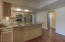 Updated & open kitchen with Hickory cabinets, granite counters, gas range & stainless appliances.