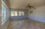 ENORMOUS LIGHT & BRIGHT LIVING ROOM WITH BACKYARD & SUNSET VIEWS!! ALL WINDOWS HAVE BLACKOUT SECURITY/STORM SHUTTERS ON EXTERIOR!