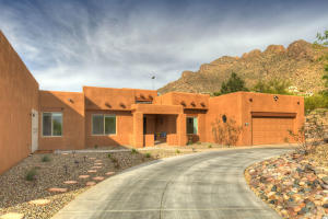 Front of house with Pusch Ridge as a backdrop