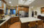 Remodeled kitchen with new cabinets, granite, stainless appliances. Breakfast bar island and skylights!