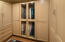 Specialty closets with built-ins and glass doors.