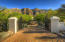 Enter into a long, nicely paved driveway...The mountain views will draw you in!