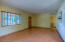 Light & bright living room features built in shelves, upgraded windows, and high end blinds!