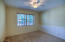 Bedroom #2 features large window, spacious closet, wood plank accent walls & ceiling fan!
