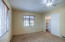 Bedroom #3 features large windows with views of blooming cactus, spacious closet & ceiling fan!