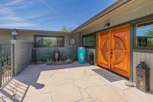 here thru the custom mahogany hand-carved doors. Pass the soothing fountain in this courtyard to the front door.