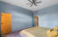 Large walk-in closet & master bath through doorway to right.